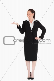 Cute woman in suit showing a copy space