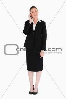 Attractive woman in suit on the phone
