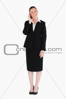 Beautiful woman in suit on the phone