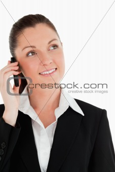 Portrait of an attractive woman in suit on the phone