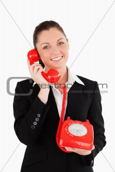 Cute woman in suit on the phone