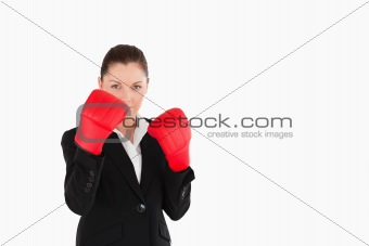 Attractive woman wearing some boxing gloves