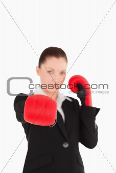 Cute woman wearing some boxing gloves