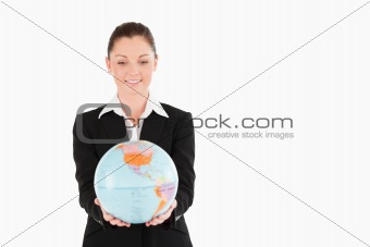 Cute woman in suit holding a globe