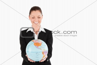Lovely woman in suit holding a globe