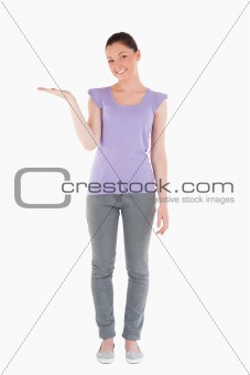 Beautiful woman showing a copy space