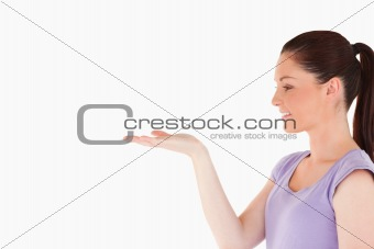 Cute woman showing a copy space