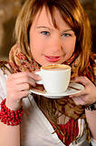 Beautiful young girl dtinking coffee