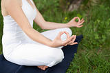Meditation in nature - Cute young girl meditates outdoor