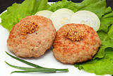 two cutlets with mustard