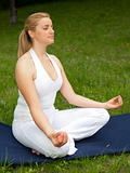 Meditation in nature - Cute young girl meditates outdoors