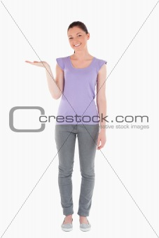 Attractive woman showing a copy space