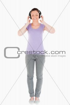 Beautiful woman posing with headphones while standing