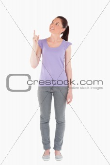 Beautiful woman pointing at a copy space