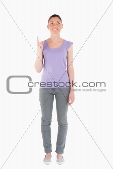 Attractive woman pointing at a copy space