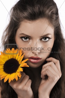 face shot of a pretty girl holding a sunflower