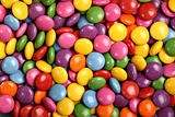 Colorful button-shaped candies filled with chocolate (chocolate beans)