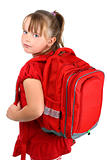 Small girl with red school bag isolated on white