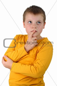 10 year old boy thinking about something with finger on lips isolated on white
