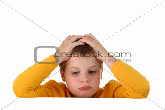 Small sad and hopeless boy holds head with hands resting arms on blank whiteboard isolated on white