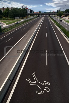 Chalk outline on the road
