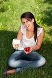 Beautiful young girl picking cherries