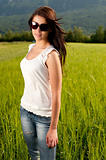 Attractive young woman on grain field