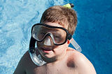 Funny boy with diving goggles
