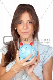 Beautiful girl with a blue piggy-bank