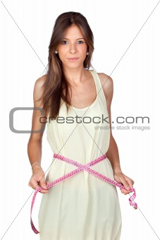 Attractive model girl with a tape-measure
