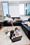 happy young family have fun and working on laptop at home