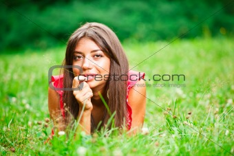 Beautiful woman lying on a grass