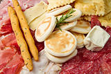 platter of cured meats, cheeses and fried dumpling