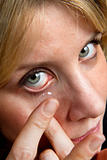 blonde girl with contact lens