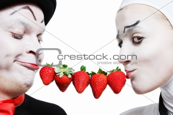 Couple of mims with the strawberry on a white background