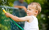 toddler and water splash