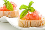 Bruschetta with tomatoes and basil isolated