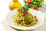 Pasta with arugula pesto and cherry tomatoes