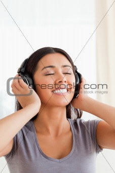 close up of woman with earphones