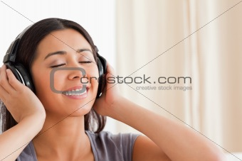 close up of woman with closed eyes and earphones
