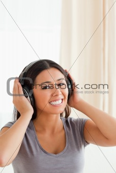 charming woman with earphones looking into camera