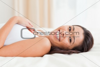 close up of a charming woman lying on bed