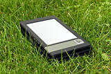 E-Book Reader in the grass