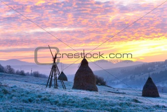 First autumn frosts and sunrise in mountain
