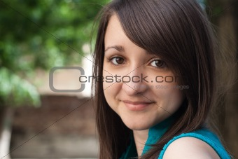 Portrait of a beautiful young brunette with hazel eyes