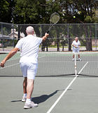 Senior Couple Plays Tennis