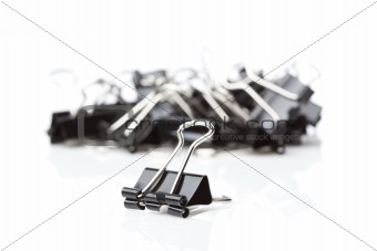 A black binder clip