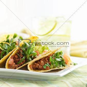 a platter of three tacos