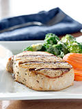 Pork loin filet with carrots and broccoli with hollandaise sauce