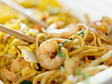 shrimp lo mein with fried rice with extremely thin focus and blurry background.
